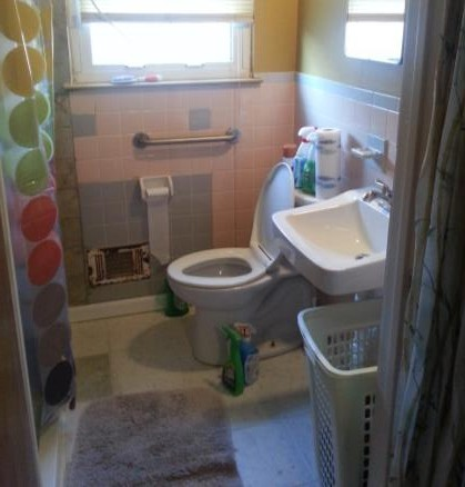 Completed bathroom entryway, grab bar and sink.