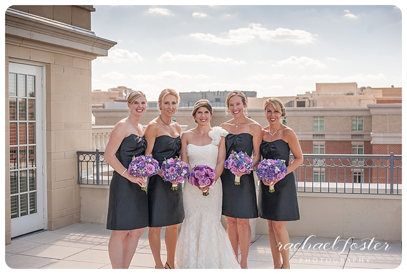 Bride and bridesmaids overlooking Alexandria, VA skyline