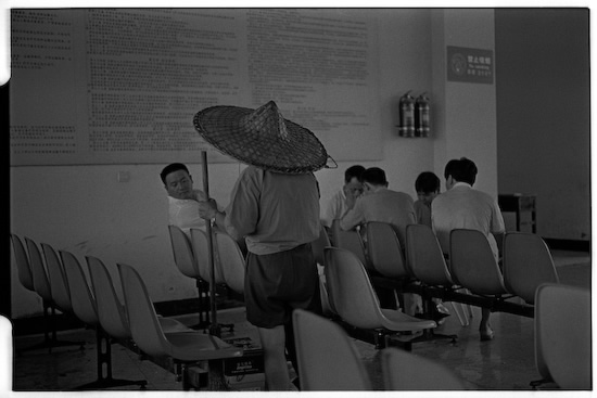 Sweeper at Yixian bus station waiting lounge (Leica M6 + 50mm f2 Summicron + Kodak Tri-X)