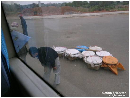 Locals load up anything and everything into the bus cargo hold