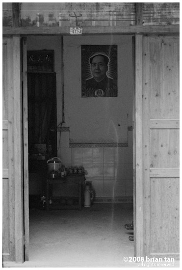 Poster of Chairman Mao still hangs on the walls in Xingping