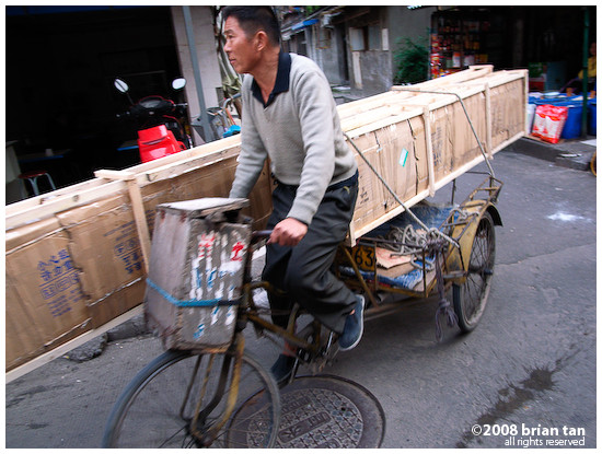 Transporting items by bicycle is common in the backstreets of Chengdu
