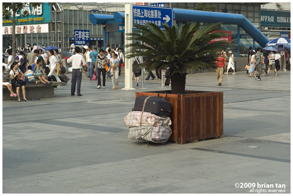 It is common to see left luggages at the station square. I waited a few minutes and I have never figured out who the owner of these sacks are.