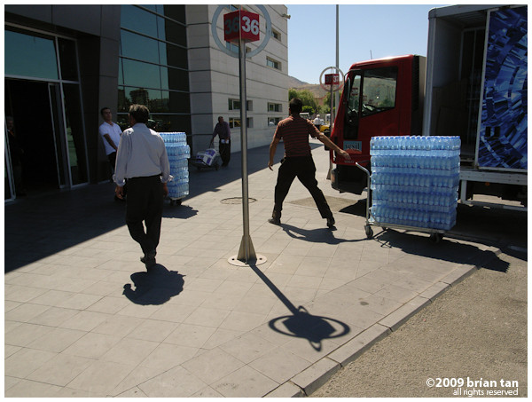 Loading up water on a hot day at the otogar...