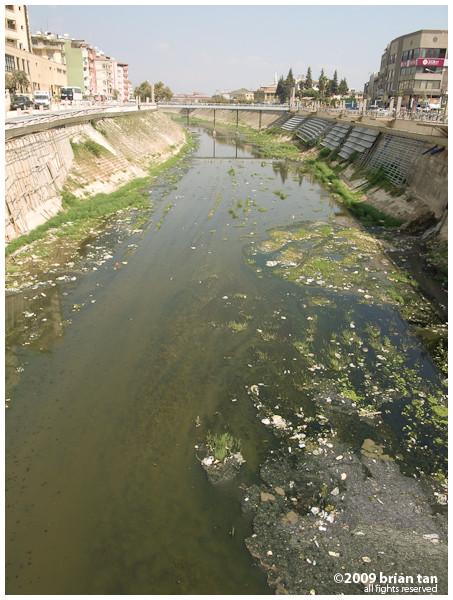 A river runs through the center of Antakya, nay, a dirty river....