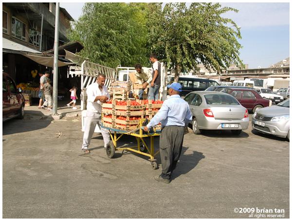Merchants unloading goods at a market