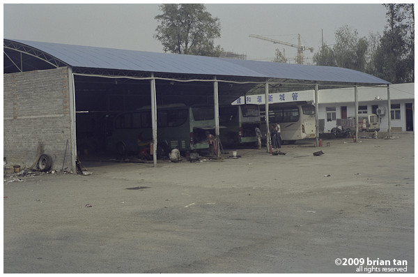 Just outside Zhoukou, the bus stops at this workshop to fill up the fuel tanks.