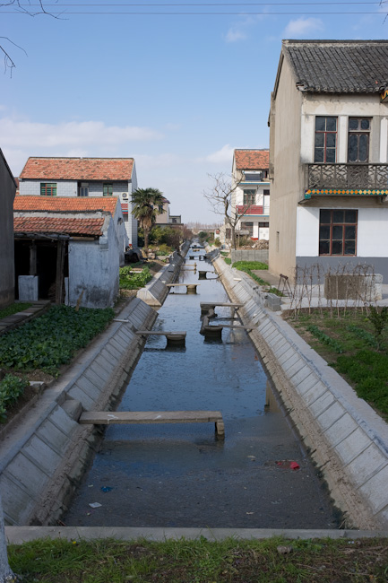 While running tap water should be available on the island, residents still make use of canals like these to do some of their washing...