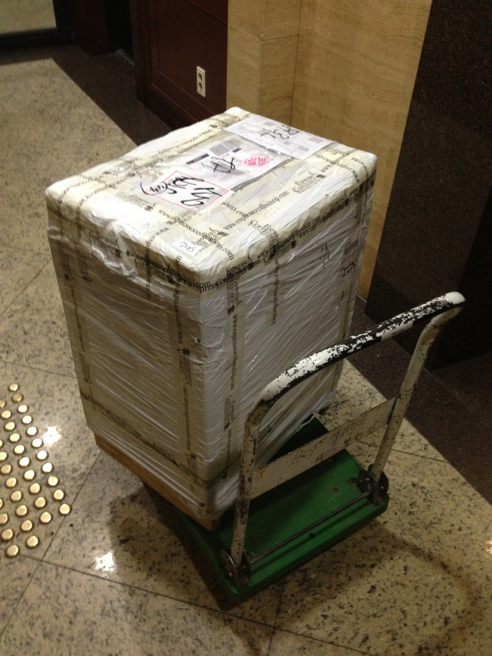The shipment arrived in a crated double box weighing easily 30kg. Cart required!