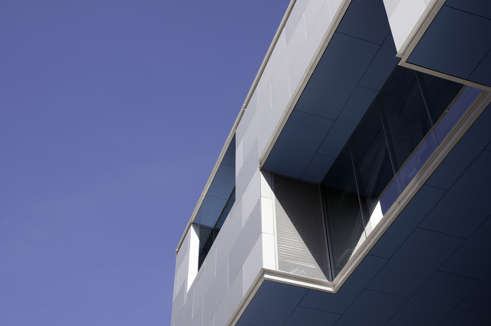 Sanded aluminum facade and cantilever.