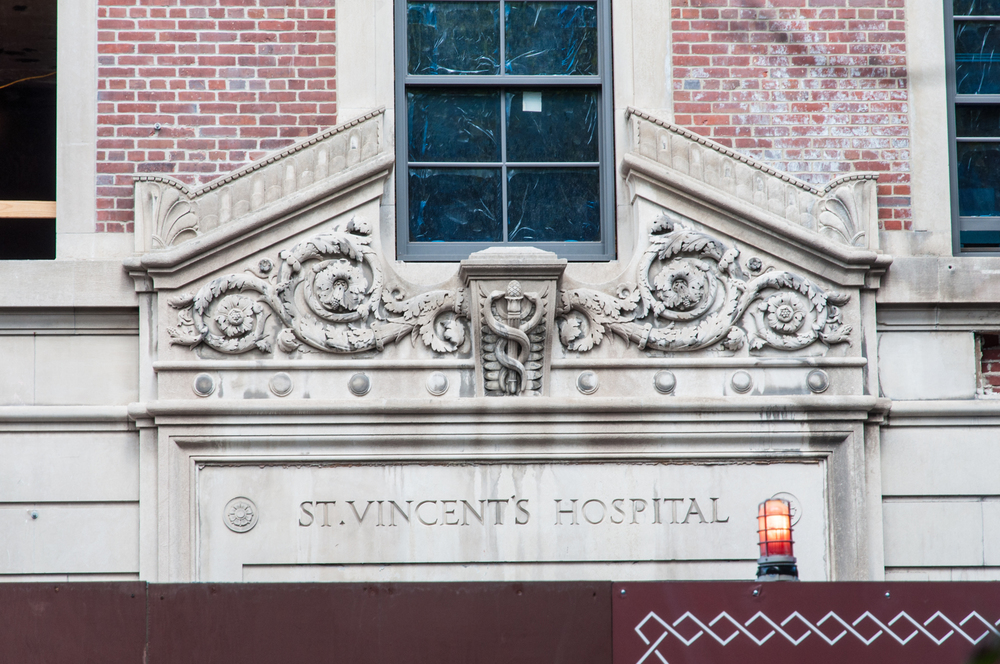 Façade ornamentation from the site's previous use preserved on 145 West 11th Street.