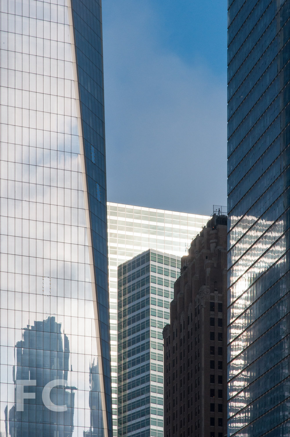 The Goldman Sachs Tower (center) amongst 1 WTC (left) and 7 WTC (right).