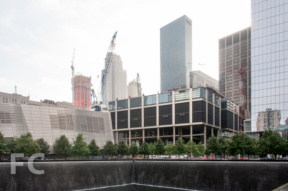 The WTC museum (left), 3 WTC (center), and 4 WTC (right) seen from the Memorial pools with 30 Park Place under construction in the background.