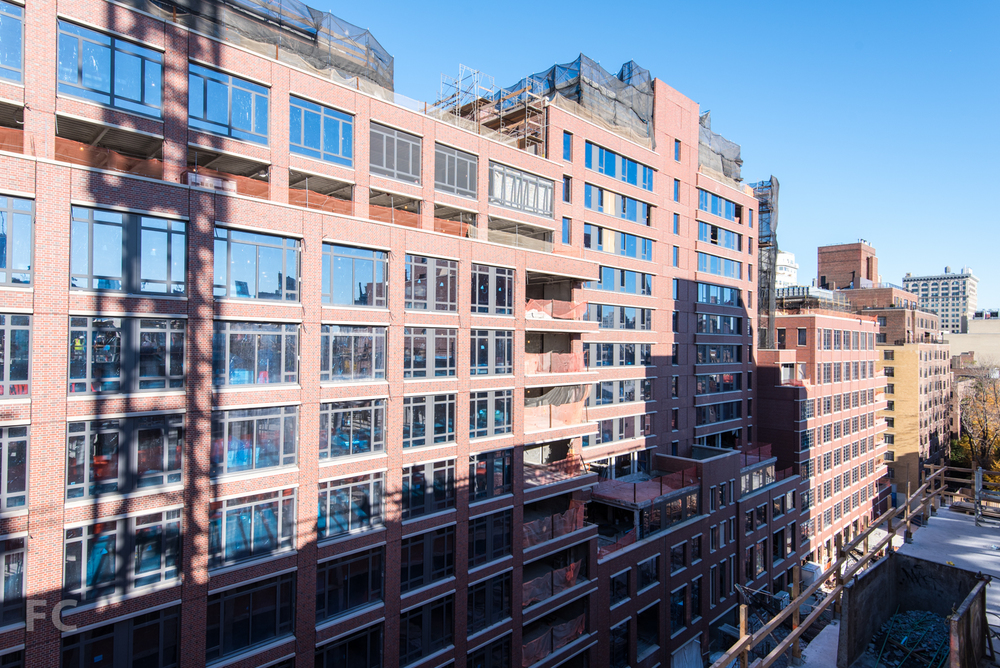 Courtyard facade of 160 West 12th Street (left), 150 West 12th Street (center), and 140 West 12th Street (right)..