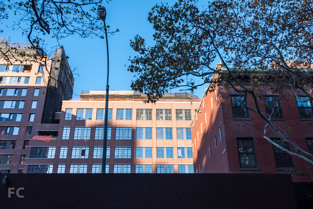View to the site of the Townhouses and the courtyard facade of 140 West 12th Street