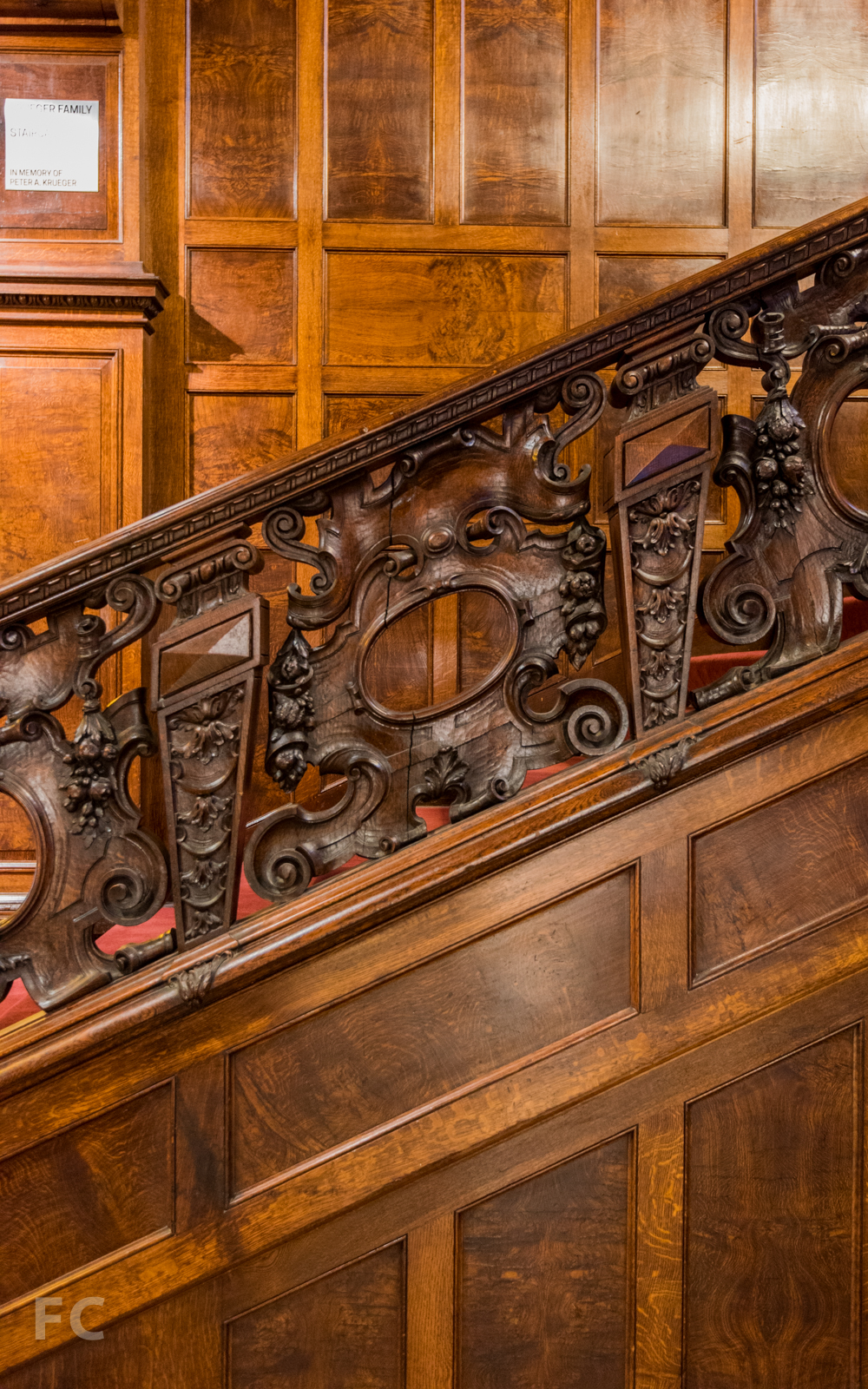 Detail of carved oak ornamentation on the great stair.