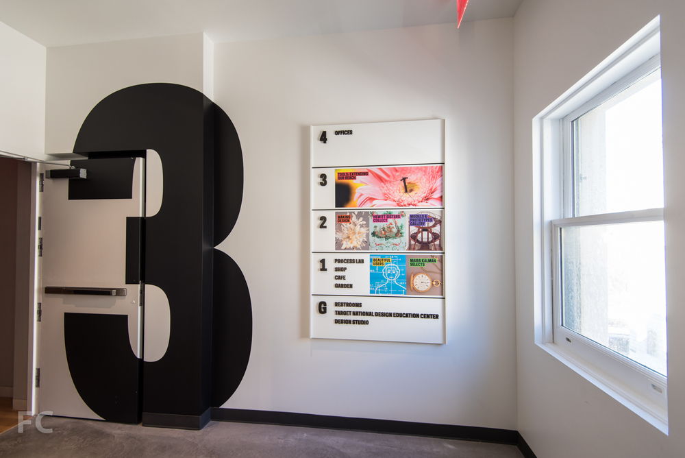 Stairwell signage and way-finding board by Pentagram.