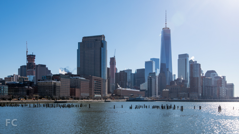 Lower Manhattan skyline with 56 Leonard (left), 30 Park Place (center), and One World Trade Center (right) from Pier 34.