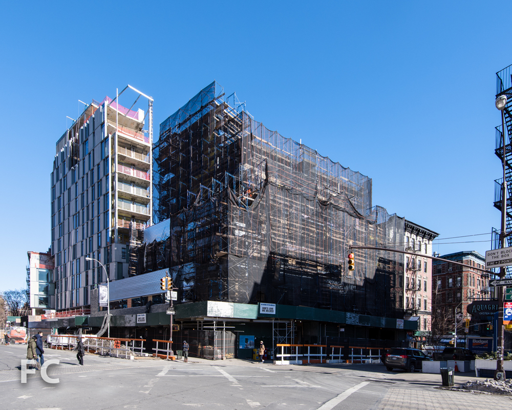 Southwest corner of 166 Avenue of the Americas (right) and One Vandam (left).