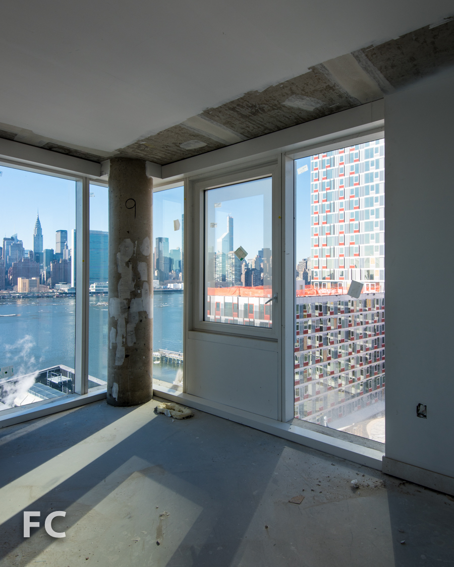 View of the Manhattan skyline and  Hunter's Point South Commons  from a corner unit in  Hunter's Point South Crossing .