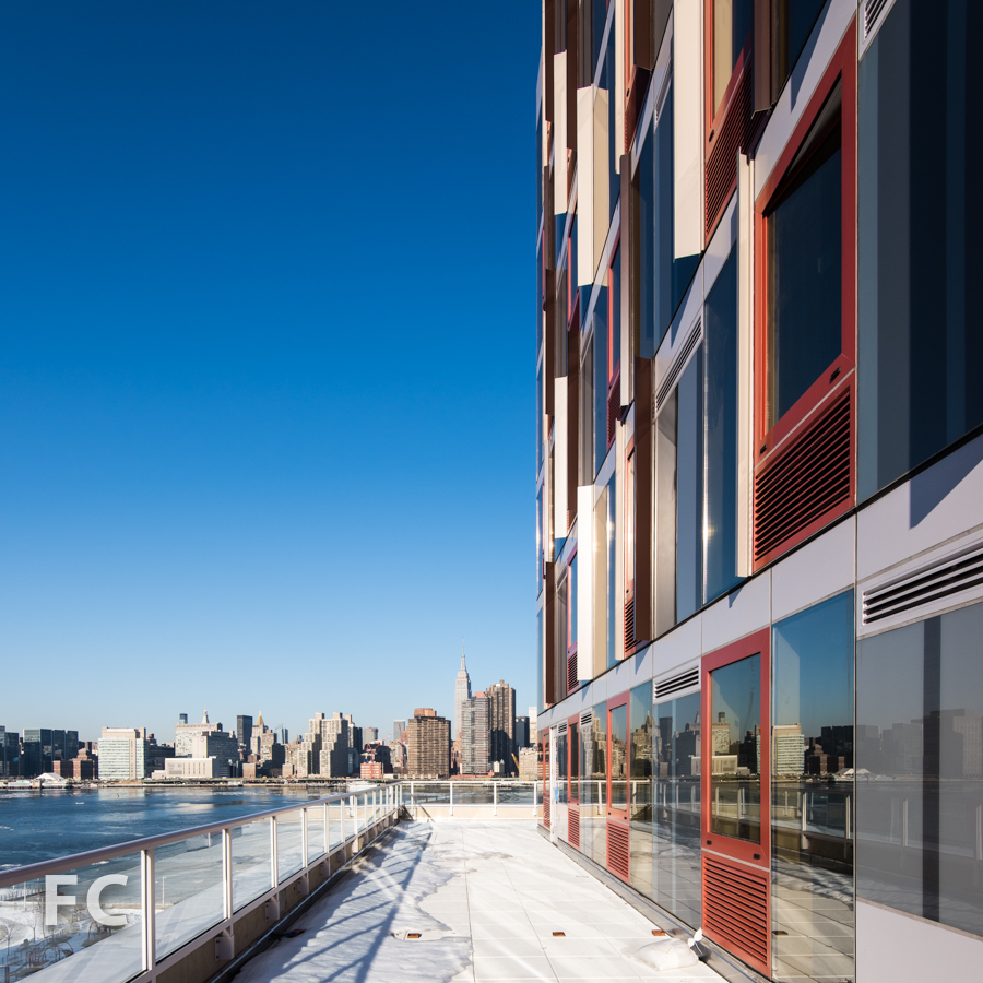 View of the Manhattan skyline from a podium terrace on  Hunter's Point South Commons.