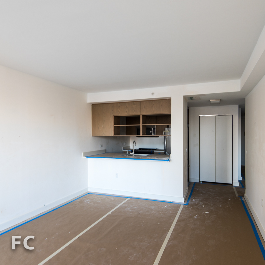 Kitchen and entry of a unit in Hunter's Point South Commons.
