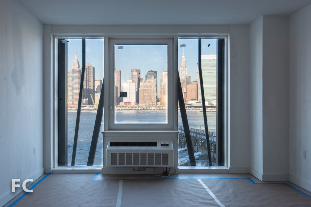 View of the Manhattan skyline from a unit in Hunter's Point South Commons.