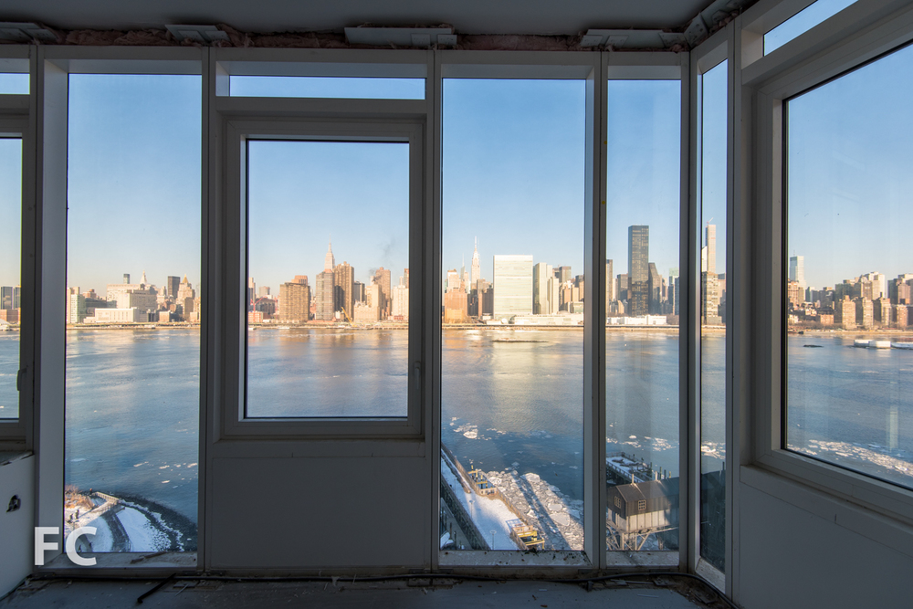 View of the Manhattan skyline from a corner unit in  Hunter's Point South Commons.