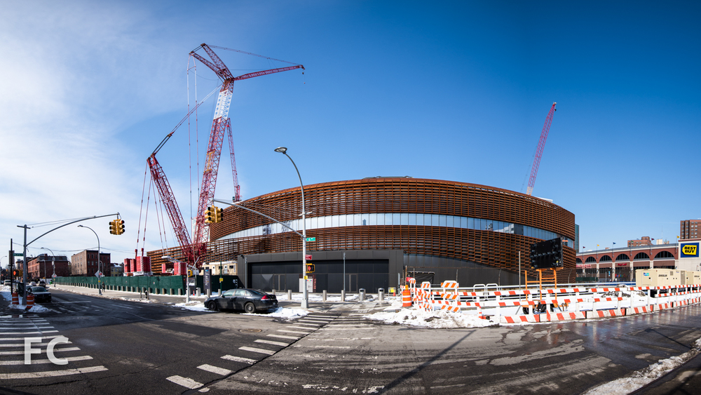East façade of Barclays Center (center) with future site of 30 6th Avenue (left) and the B4 tower (right).