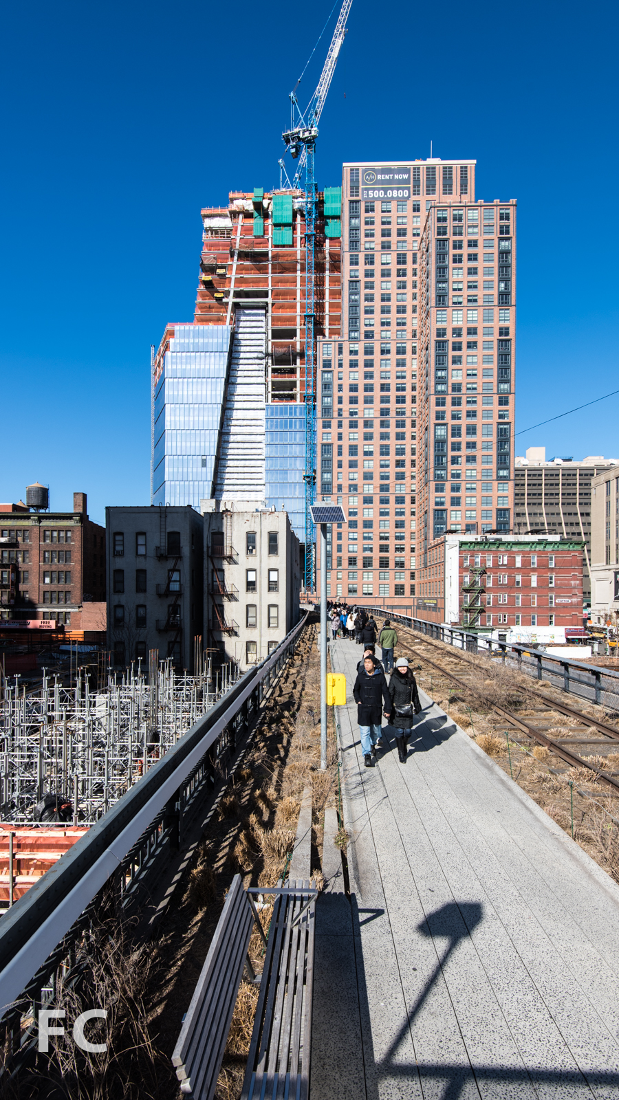 South facade of 10 Hudson Yards (left) and the Abington House (right) from the High Line park.