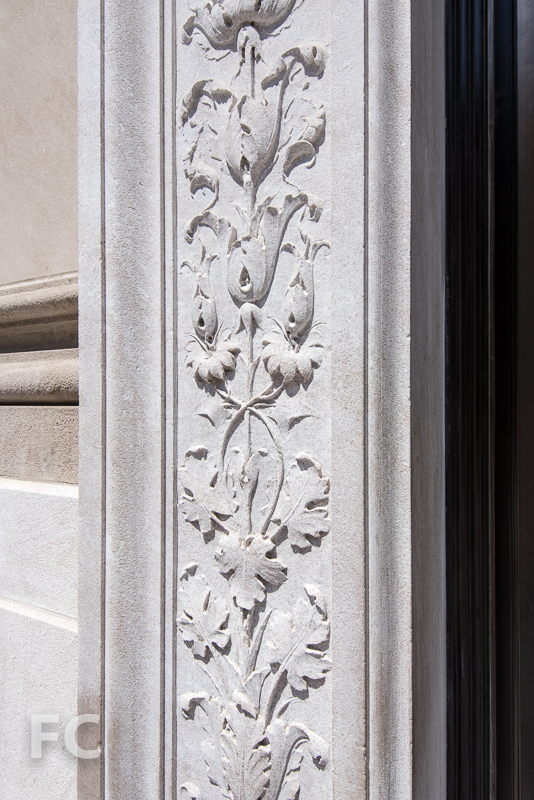 Exterior ornamentation at the entry door.