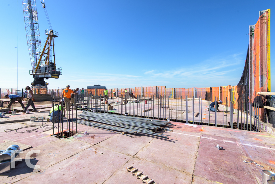 Workers prepare the 50th floor slab for the concrete pour.
