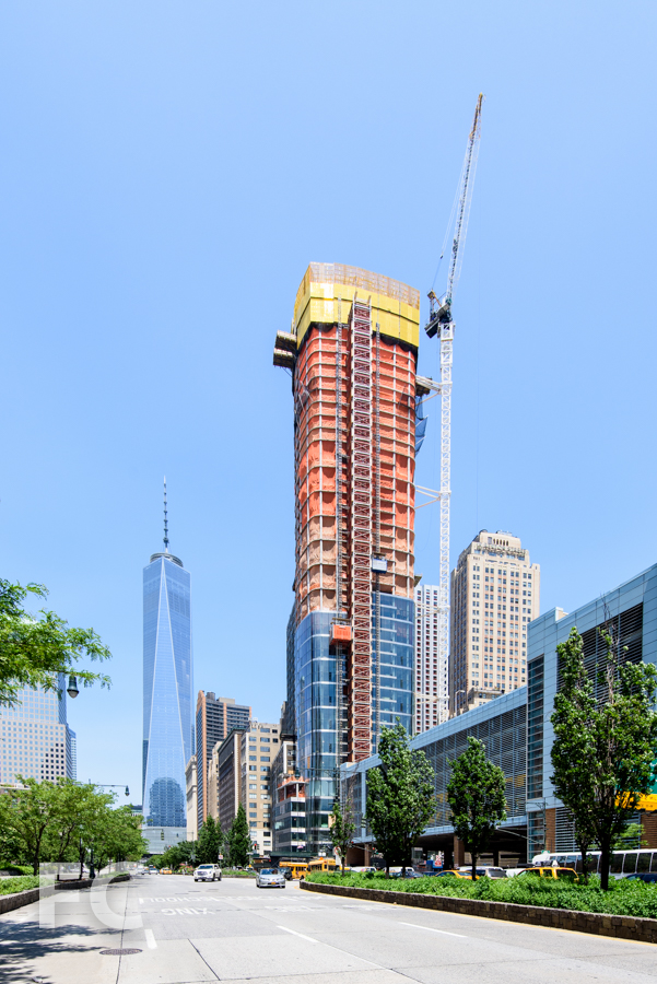 Looking north from West Street towards 50 West (center) and One World Trade Center (left).