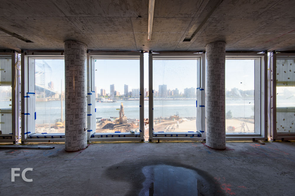 Curtain wall panels installed on a lower floor.