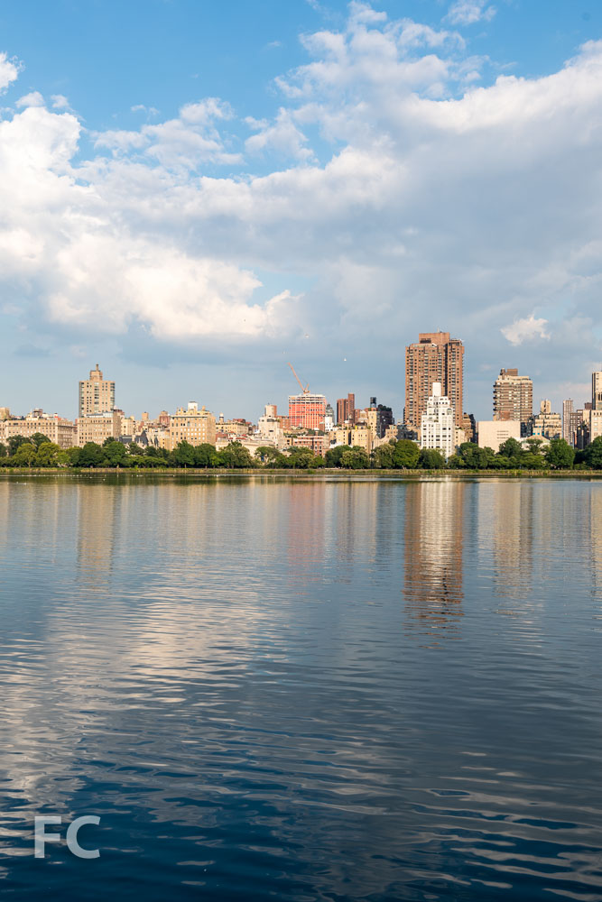 A view of the tower on the Upper East Side skyline from the reservoir in Central Park.
