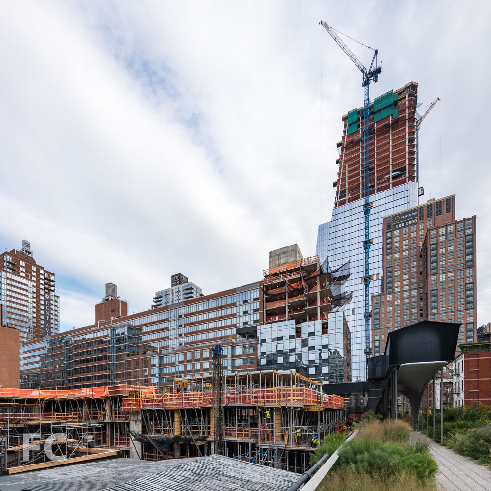 Looking north along the High Line with tower three (center) rising behind 520 W 28.