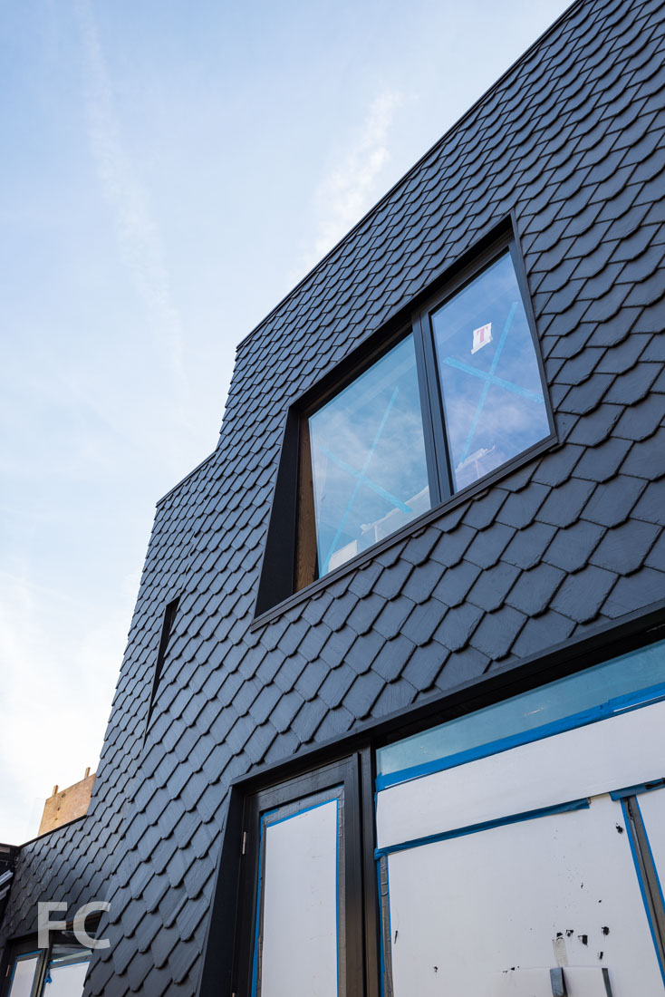 Slate shingled facade of the penthouse.