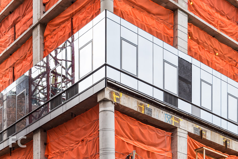Curtain wall detail at the southwest corner of 401 West 31st Street.