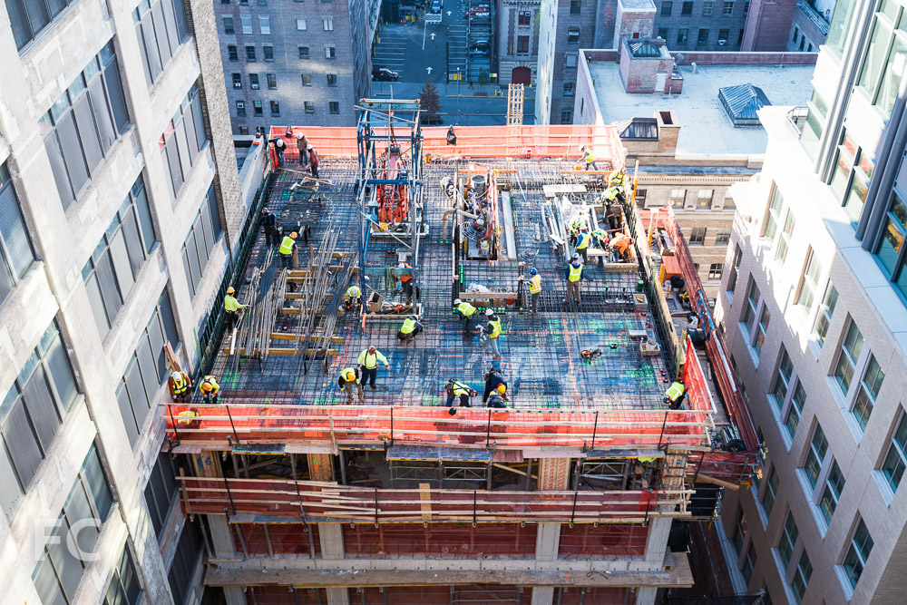 Workers prepare the 15th floor slab of the Vandam Street tower.
