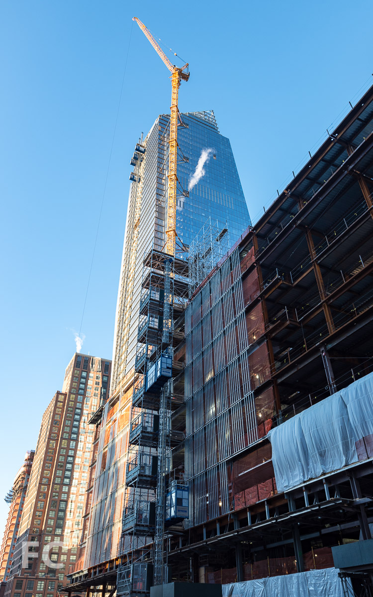 Looking up at the northeast corner of 10 Hudson Yards and the retail podium from 10th Avenue.