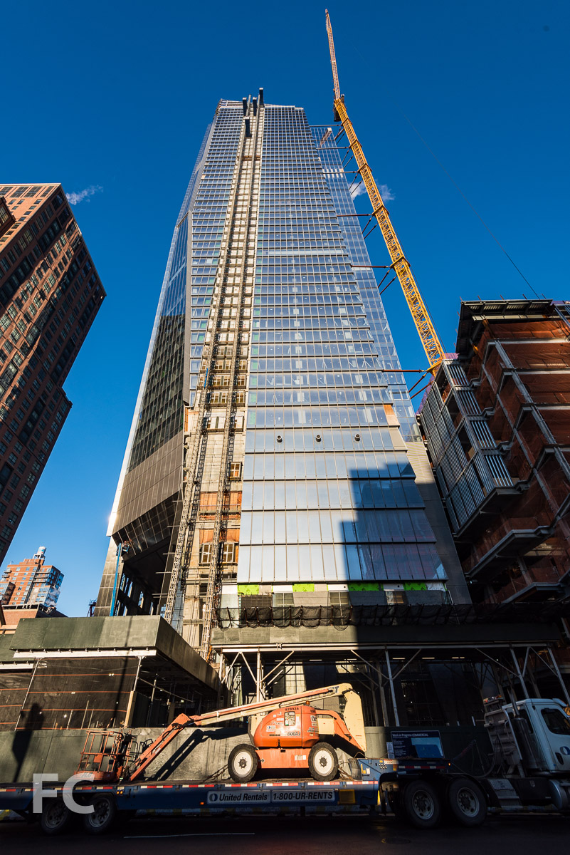 Looking up at the east facade of 10 Hudson Yards from 10th Avenue.
