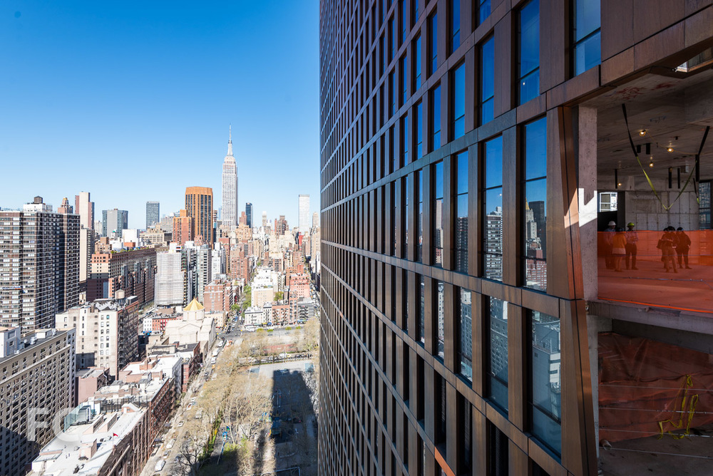 A view of the Empire State Building and the copper facade from the skybridge.
