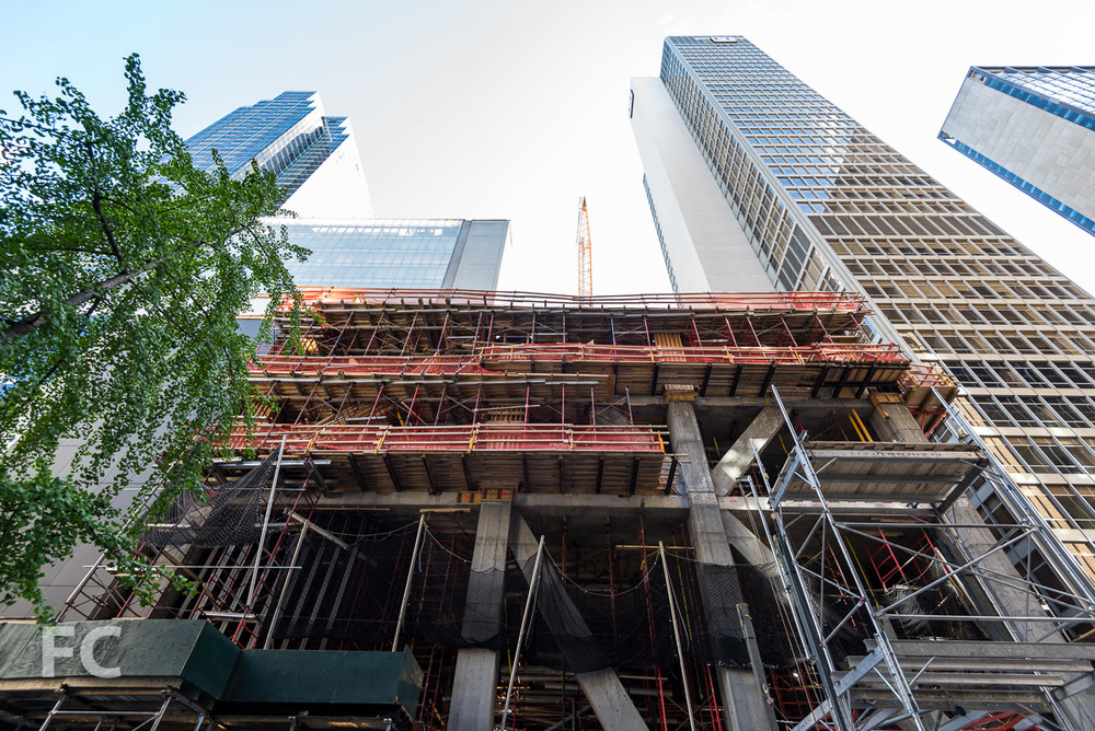 Looking up at the north facade from West 54th Street.