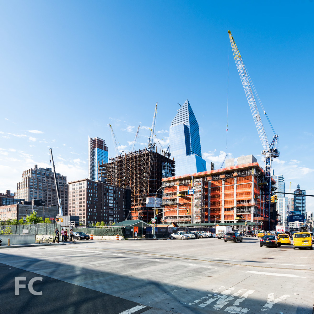 Northwest corner of the Eastern Rail Yards from West 34th Street and 11th Avenue, with 30 Hudson Yards (center), 10 Hudson Yards (right), and 55 Hudson Yards (far right).
