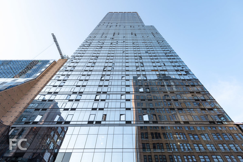Looking up at the south façade of 401 West 31st Street.