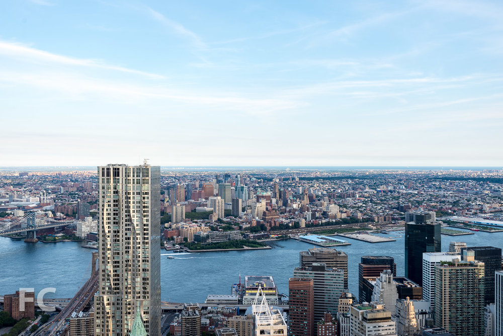 The Lower Manhattan skyline with Brooklyn Bridge Park and the Downtown Brooklyn skyline in the background.