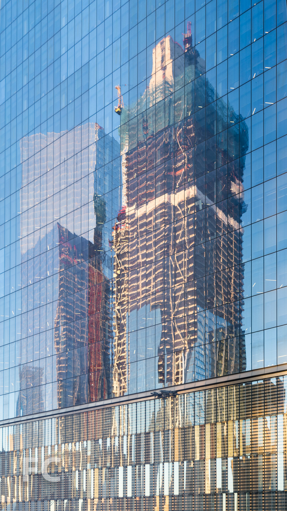 Reflections of 3 and 4 World Trade Center on the facade of 1 World Trade Center.