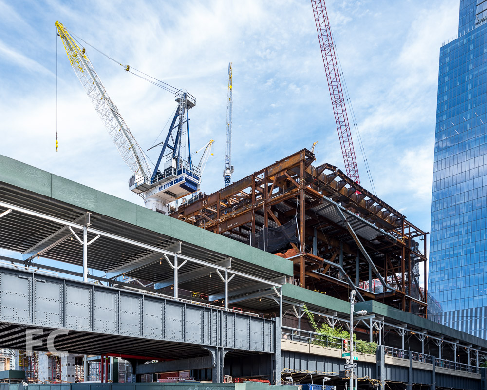 Southwest corner of The Shed's superstructure rising above the High Line.