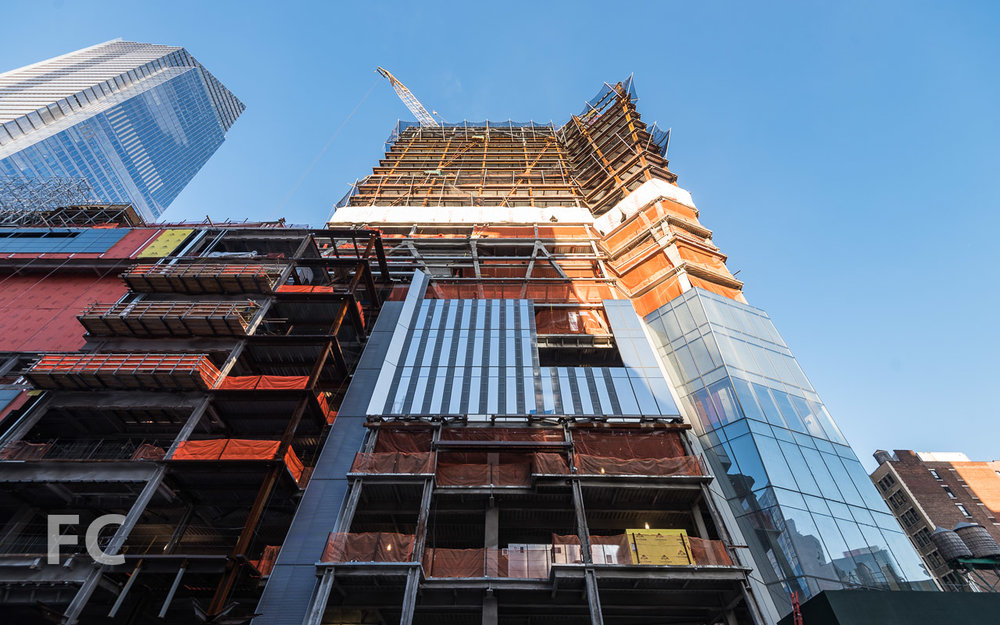 Looking up at the east façade of 30 Hudson Yards from 10th Avenue.