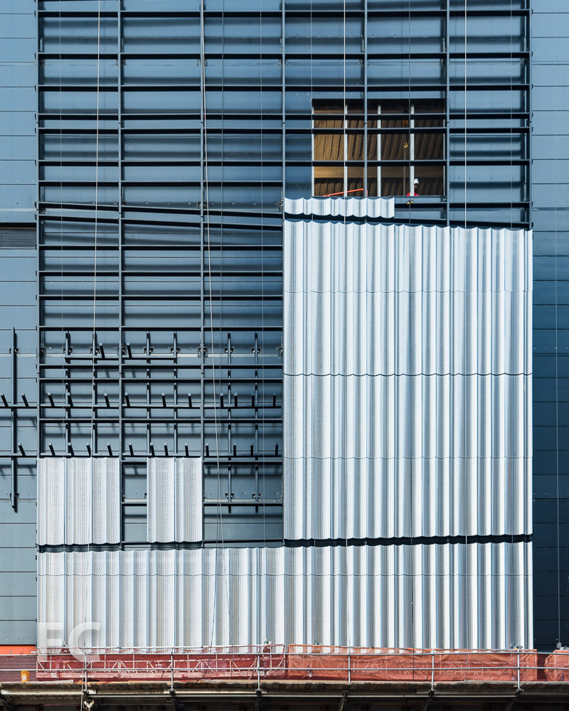 Close-up of the metal panels at the east façade of the retail building.